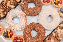 Doughnuts covered  with white and brown chocolate Royalty Free Stock Images