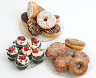 Doughnuts, cupcakes, and apple fritters Stock Photo