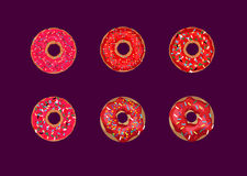 Doughnuts. Donuts in the red glaze on a dark background Royalty Free Stock Images