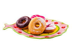Doughnuts on a fish shaped plate Royalty Free Stock Photo