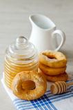 Doughnuts. With honey on the kitchen towel Stock Photography