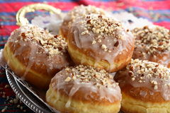 Doughnuts with icing and cashews Royalty Free Stock Photography