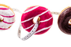 Doughnuts and measuring tape Royalty Free Stock Photography