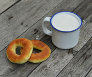 Doughnuts and milk on old table Stock Images