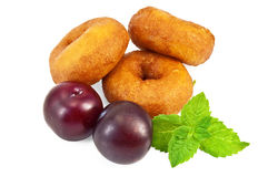 Doughnuts with mint and plums Stock Photography