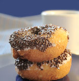 Doughnuts with sprinkles Stock Images