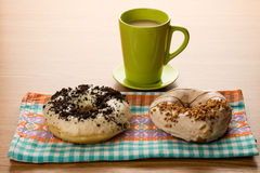 Doughnuts on tablecloth Royalty Free Stock Images