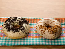 Doughnuts on tablecloth Stock Photo