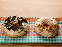 Doughnuts on tablecloth Stock Photo