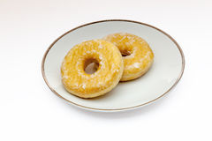 Doughnuts. View of a plate with two Doughnuts on a white background Royalty Free Stock Photos