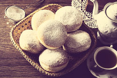 Doughnuts in wicker basket view from above with strainer vintage Stock Images