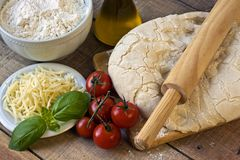 Dought for italian pizza preparation Royalty Free Stock Image