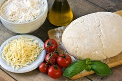 Dought for italian pizza preparation Royalty Free Stock Images