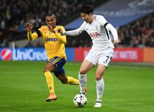 Douglas Costa and Heung-Min Son. Players pictured during the UEFA Champions League Round of 16 game between Tottenham Hotspur and Juventus Torino held on March 7 Royalty Free Stock Photography