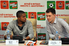 Douglas Costa  and translator. On April 8, the press center of Donbass Arena hosted the meeting between the fans and the players of Shakhtar Darijo Srna, Douglas Stock Images