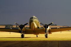 Douglas DC-3 on the runway. And storm as background Stock Images