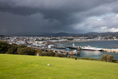 Douglas Isle of Man. Ferry Terminal and town of Douglas Isle of Man and approaching storm royalty free stock image