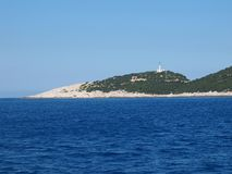 Doukato do cabo Lefkatas (ou do Kavo) e o farol na parte sul da ilha de Lefkada, Grécia Fotos de Stock Royalty Free