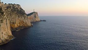 Doukato lighthouse at Lefkatas cape during sunset, Greece, time lapse gopro stock footage