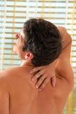 Douleur dans le dos. Images libres de droits