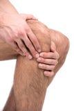 Douleur dans un genou photos stock