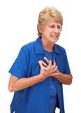 Douleurs de coffre aînées mûres de femme d'isolement Photo stock