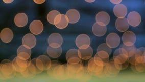 Dourado, borrado, o bokeh ilumina o fundo vídeos de arquivo