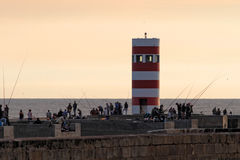 Douro river mouth fishing point. Porto, Portugal - October 19, 2015: South pier of Douro River mouth in a beautiful end of the day, full of anglers. Excellent Royalty Free Stock Image