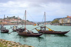Douro river with rabelos boat and port wine barrels at Porto Oporto city Stock Images