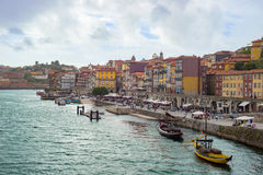 Douro river, Ribeira quarter with market promenade and boats, Porto Oporto city Royalty Free Stock Image