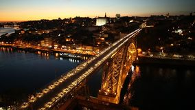 Douro River skyline at sunset. Aerial view of Oporto skyline and Ribeira Waterfront from Dom Luis I Bridge at twilight. Picturesque urban cityscape of Porto in stock video