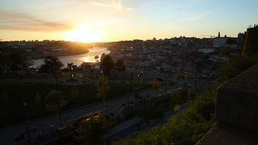 Douro River at sunset. Aerial panoramic view of Oporto skyline and Ribeira Waterfront from Dom Luis I Bridge at twilight. Picturesque urban cityscape of Porto stock footage