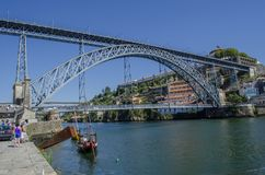 Douro river, traditional boats and Dom Luis or Luiz iron bridge. stock photography