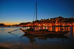 Douro river and traditional boats at night in Oporto royalty free stock photo