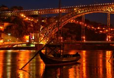 Douro river and traditional boats at night in Oporto stock photos