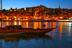 Douro river and traditional boats at night in Oporto stock image