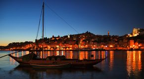 Douro river and traditional boats at night in Oporto royalty free stock photos