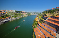 Douro river and wineries, Porto, Portugal. Aerial view to Douro river with traditional portuguese boats in Porto, Portugal, and wineries on the right side Stock Image
