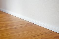 Doussie parquet floor stock photo