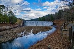 Douthat Lake Upper Dam and Spillway. Millboro, VA – February 21st: A view of the upper dams and spillway at Douthat Lake located at Douthat State Park in stock photos