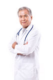 Doutor asiático experiente, cruzamento do braço Foto de Stock Royalty Free