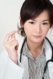 Doutor asiático novo fotografia de stock
