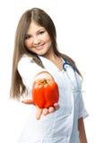 Doutor bonito que dá nos uma pimenta Imagens de Stock