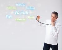 Doutor clínico que aponta à coleção da saúde e da aptidão do wor Imagem de Stock