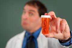 Doutor com comprimidos fotografia de stock