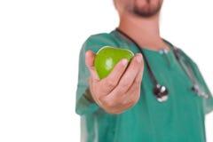 Doutor com uma maçã Foto de Stock Royalty Free