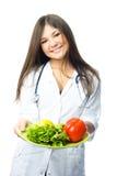 Doutor com vegetais Fotos de Stock