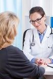 Doutor Comforting Female Patient imagem de stock royalty free