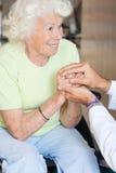 Doutor Comforting Senior Woman fotos de stock