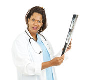 Doutor confuso Com Raio X Resultado Fotografia de Stock Royalty Free